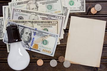 Light bulb with dollars