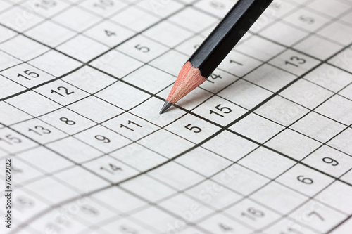 crossword sudoku and pencil, popular puzzle game with numbers