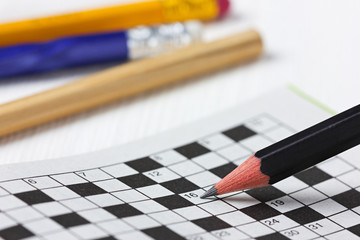crossword puzzle and pencils