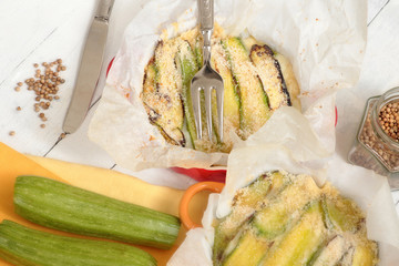 zucchini parmigiana close up with ingredients and spices