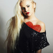 beautiful young woman.blond girl.Valentines day.Heart Sign