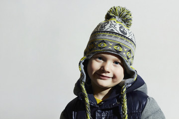 funny child.winter fashion kids.smiling fashionable little boy