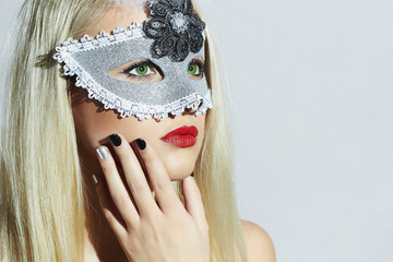Beautiful Blond Woman in Mask.Young Girl.Manicure Shellac