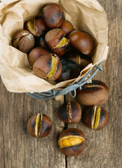 roasted chestnuts on wooden surface