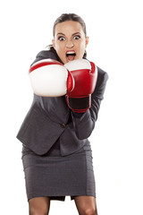Front view of angry business woman, attack with boxing gloves
