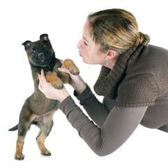 puppy malinois and woman