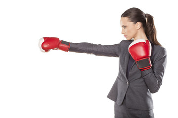 Profile of a business woman, attack with boxing gloves
