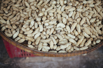 Whole peanuts in a bowl on market.