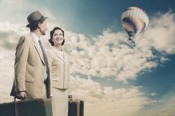 Elegant couple leaving with luggage