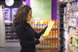 Woman in supermarket - 76302320