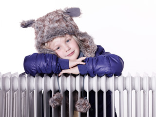 Cute girl with pelt cap and radiator