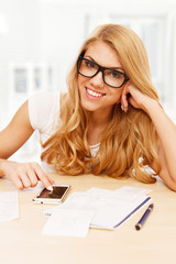 Young woman doing her accounts