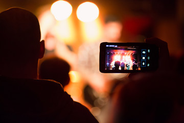 Taking a video with the smartphone during a concert