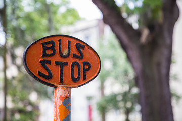 Orange Bus Stop Sign
