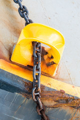 Rusty Iron Chain Through Yellow Guide