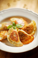 Fried dumplings filled with mushrooms and cabbage