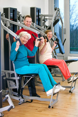 Happy Old Women at the Gym Assisted by Instructor.