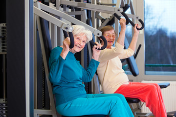 Fit Elderly Ladies Working Out at the Gym.