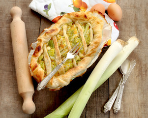 quiche with leeks, vintage silverware and rolling pin