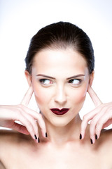 Beauty portrait of a cute woman closed ears by her hands