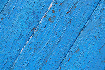 cracked wooden surface  blue background