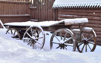 cart for the horse stands in the yard