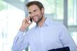 Smiling businessman having phone call - Successful businessman