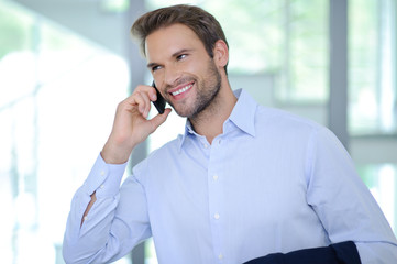 Smiling businessman having phone call - Successful businessman