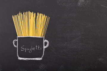 Spaghetti on chalkboard and drawn pot with copy-space