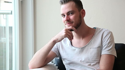 Young attractive man sitting down