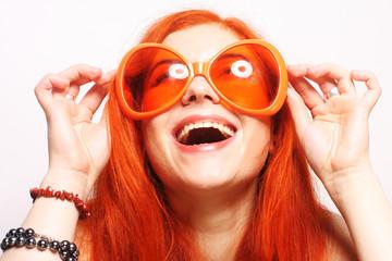 funny redhair woman in big orange glasses