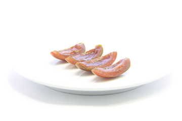 Black flesh tomato sliced without seed ingredient on white plate