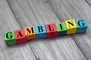 word gambling on colorful wooden cubes