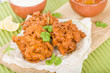 Onion Bhajis - Asian fritters with lime chutney and mint raita. - 76312590