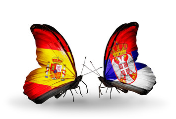 Two butterflies with flags Spain and Serbia