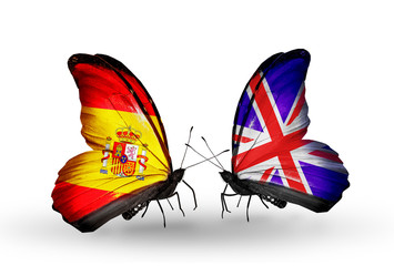 Two butterflies with flags Spain and UK