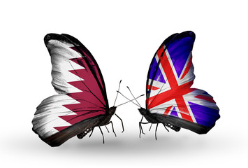Two butterflies with flags Qatar and UK