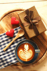 vintage color tone of  cup of coffee with red heart on the table