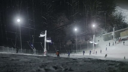 People skiing at night