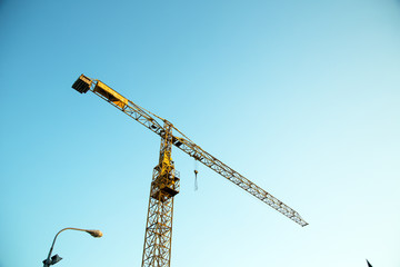 Industrial crane against blue sky