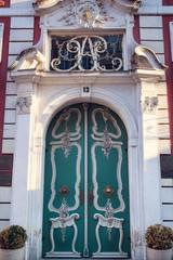 Old wooden door with ornaments