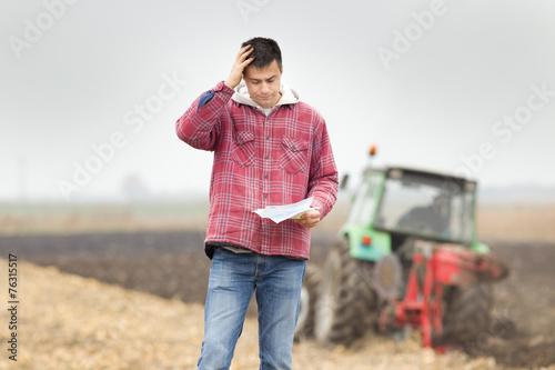 Worried man on the field - 76315517
