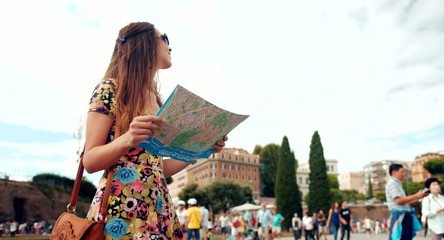 Attractive Young Female Walking Through Rome with Map
