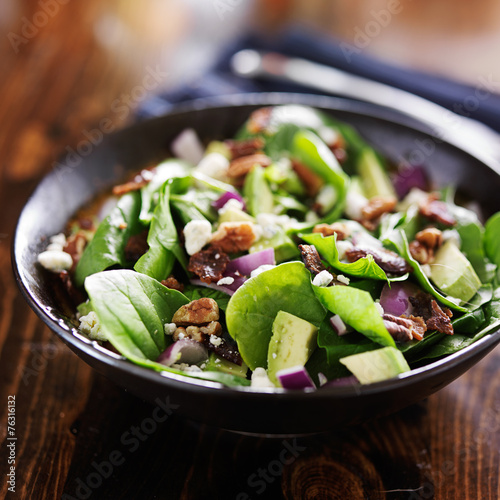 avocado spinach salad with feta cheese, pecans and bacon - 76316132