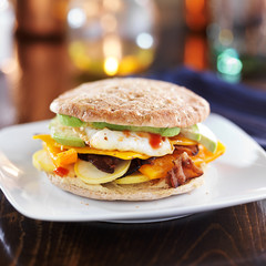 healthy breakfast sandwich with egg, bacon, avocado