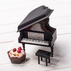 Candy and miniature grand piano on a paper napkin