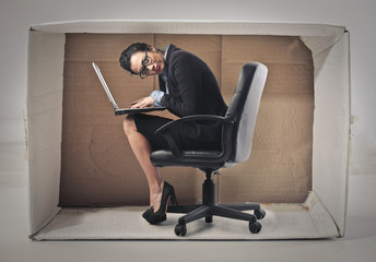 Businesswoman hiding in the box