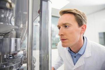 Focused pharmacist using advanced technology