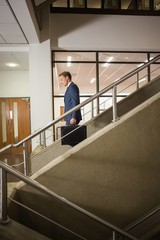 Businessman going down the stairs