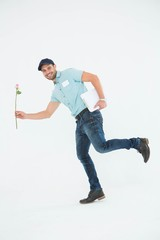 Flower delivery man running on white background